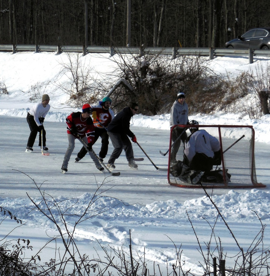 High school hockey alumni on Erie Canal ice.