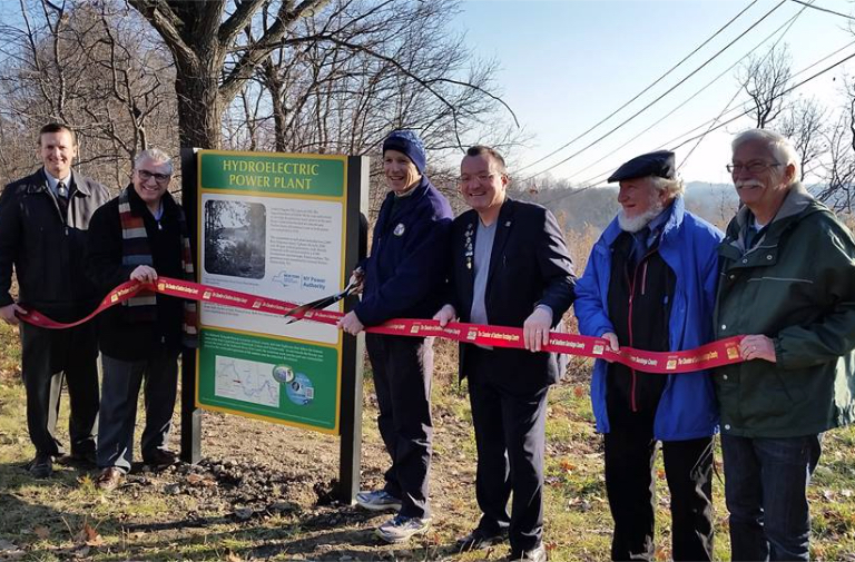 Unveiling and ribbon cutting at the Lock 7 Dam Overlook with Clifton Park Supervisor Phil Barrett, Assemblyman Jim Tedisco, Eric Hamilton, Chamber CEO Peter Gardenias, Larry Sydek, and John Scherer. - photo provided by Phil Barrett.